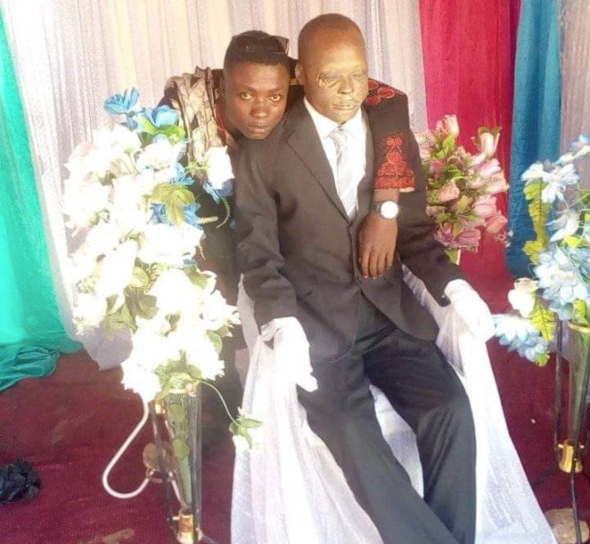 man poses with dead father