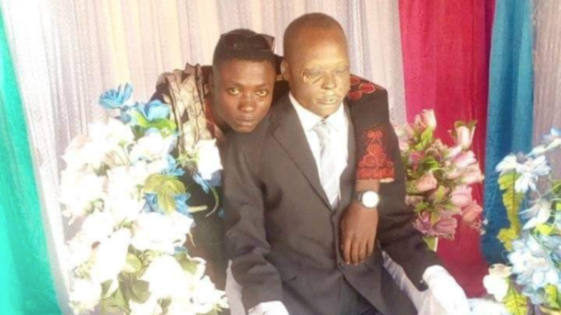 Man Poses For Some Pictures With His Dead Father